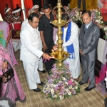 Int Women Day Lighting of traditional oil lamp